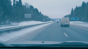 Driving on day winter road. View through drivers windshield. stock footage