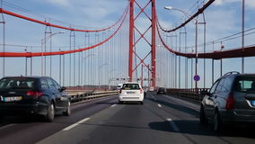 Driving through the 25 de Abril bridge from the south towards Lisbon stock footage