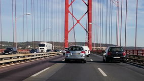 Driving through the 25 de Abril bridge from the south towards Lisbon stock video footage