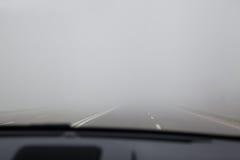Driving in a dense fog. Driving the car in a dense fog Stock Photos