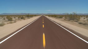 Driving on desert road stock footage