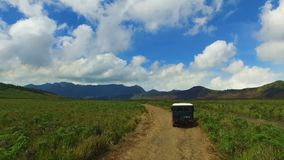 Driving through a desolated area at the Bromo volcano on Java stock video