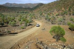Driving on a dirt road. Red Australian rural road with approaching jeep.  Australia Royalty Free Stock Photo