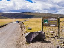 Dirt road that leads to Limpiopungo Lagoon, Cotopaxi National Park, Ecuador. Driving on dirt road that leads to Limpiopungo Lagoon, Cotopaxi National Park Stock Photo