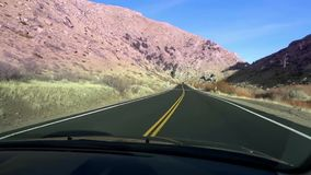 Driving Down Desert Road In Death Valley