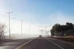 Driving down foggy highway in Malibu Creek State Park Royalty Free Stock Photo