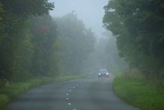 Driving down a misty morning road Royalty Free Stock Images