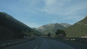 Driving down picturesque road with mountain view stock video footage
