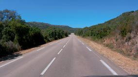 Driving Down the Road in Corsica stock footage