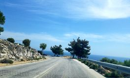 Driving down the road on Thassos Island in Greece stock photography