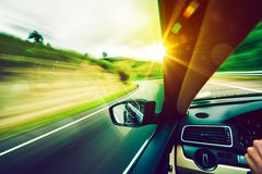 Driving Down the Road. Road to the Sun. Modern Car Driving royalty free stock photo