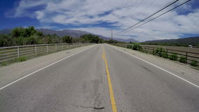 Driving down Rural Country Road Wide Angle. POV of driving down rural country road in afternoon stock footage