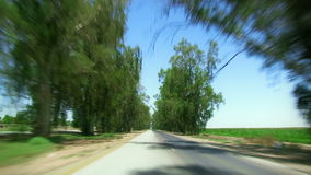 Driving down tree lined highway. Driving down tree lined two lane highway stock video footage