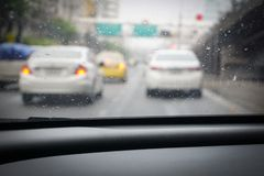 Driving from the driver`s perspective in the rain stock photo