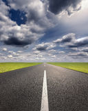 Driving on an empty asphalt road at idyllic sunny day Royalty Free Stock Photos
