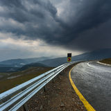 Driving on an empty asphalt road at stormy weather Stock Images