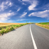 Driving on an empty asphalt road at sunny day Royalty Free Stock Photos
