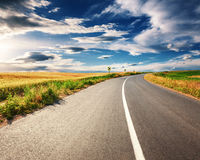 Driving on an empty asphalt road at sunny day Royalty Free Stock Photography