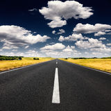 Driving on an empty asphalt road at sunny day Royalty Free Stock Photo