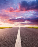 Driving on an empty asphalt road at sunset royalty free stock photography