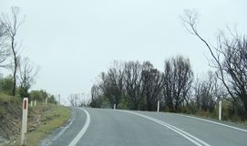 Driving on empty Cloud day highway in Tasmania. Driving on cloud filled highway in Tasmania in the town of Sorell to Port Arthur Stock Photography