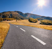 Driving on an empty highway at beautiful sunny day Royalty Free Stock Image
