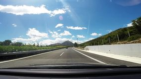 Driving on an empty highway south of Greece,