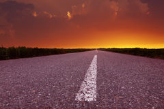 Driving on an empty road at beautiful sunset Royalty Free Stock Photography