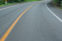 Driving on an empty road in country. The empty road in country Royalty Free Stock Photo