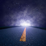 Driving on an empty road at night Royalty Free Stock Photos