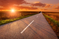 Driving on an empty road at sunset Royalty Free Stock Image