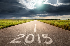 Driving on an empty road to new 2015 Stock Images