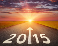 Driving on an empty road to 2015 Stock Image