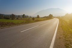 Driving on an empty road towards the mountain Stock Photography