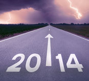 Driving on an empty road towards oncoming stormy 2014 Stock Image