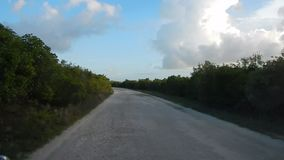 Driving on an empty road in Zanzibar. In Africa stock video footage