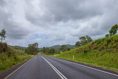 Driving in the empty roads Australia. Road trip: driving in the empty roads of Qeensland Australia Royalty Free Stock Photo