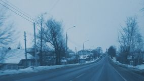 Driving on evening winter road. View through drivers windshield. stock footage