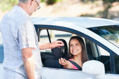 Driving exam. Student driver passes exam and instructor hands her keys Royalty Free Stock Photos
