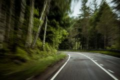 Driving fast through country roads dangerously could lead to fat royalty free stock photo