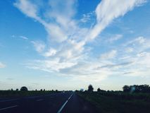 Driving. Fast on empty streets #sky Royalty Free Stock Photos
