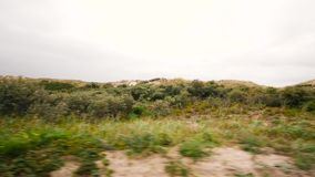 driving fast through the Netherlands dunes stock footage