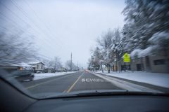 Driving fast in a school zone. Motion blur while driving with the school zone up ahead Royalty Free Stock Images