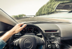 Driving fast with a sport car Stock Images