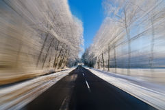 Driving fast at winter time Royalty Free Stock Photo
