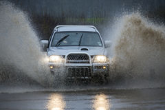 Driving on a flooded country road Royalty Free Stock Photos