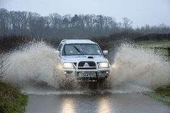 Driving on a flooded country road Royalty Free Stock Photo