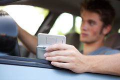 Driving: Focus on Cell Phone Royalty Free Stock Image