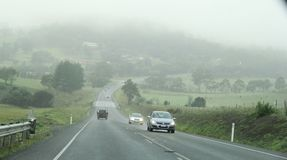 Driving in fog filled highway in Tasmania. Driving on cloud filled highway in Tasmania in the town of Sorell to Port Arthur Royalty Free Stock Photo