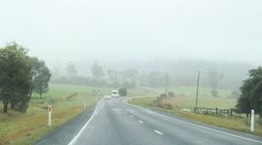 Driving in fog filled highway in Tasmania. Driving on cloud filled highway in Tasmania in the town of Sorell to Port Arthur Royalty Free Stock Photos